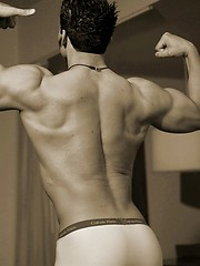 Muscled straight guy posing