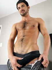The first thing you notice about Travis James in his newest Randy Blue video is his \\\'Dumb Jock\\\' T-shirt.  Now, we can tell you that Travis is anything but, however, always one to give your virtual balls a tug, Travis knows what gets people off.  The