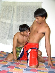 Asian daddy and two younger boys fucking