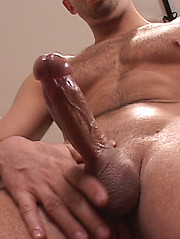 Naked stud plays with own dick