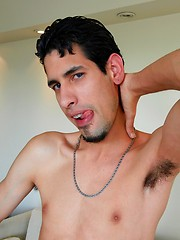 Latin stud masturbates his big uncut cock