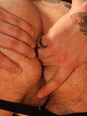 Inked dude demonstrates his tattoed dick