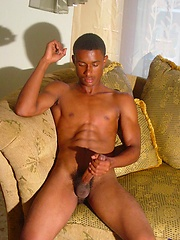 Black stud jacking his cock and load semen on own brown chest