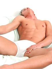Twink grabs his crotch and poses for the camera