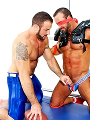 Two hunky footbal players playing with each other bodies