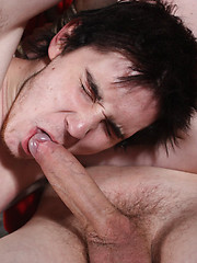Stud Jonny ordeal continues to suck on the big dick of his captor