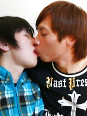 Japanese gay boy Yuu being spanked and cuddled by Tsuyoshi