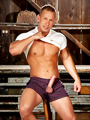 Muscled cowboy undress his clothes and show strong body
