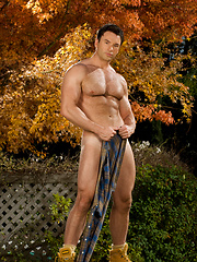 Strong muscle gay posing in the garden