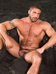 Big muscle man shows his hairy body outdoors