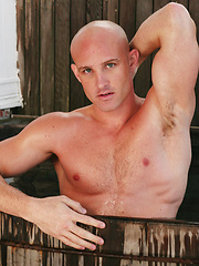 Bald gay man posing