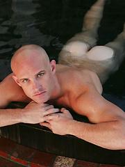 Bald gay man posing