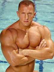 Muscle man  in a pool
