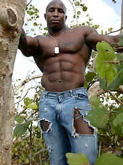 Ebony bodybuilder outdoors