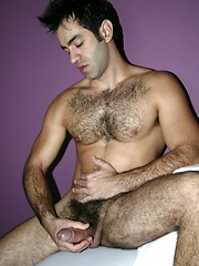 Horny latino macho shows his hary body and fat uncut cock