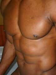 Bald black guy shows his uncut dick