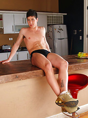 Hot boy gets naked in the kitchen