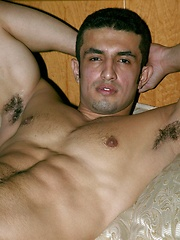 Brunette guy showing his perfect latin body