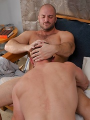 Adam gladly slams his hard cock down Davids throat making him gag on it