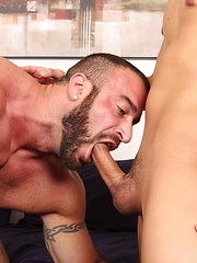 Massive daddy Spencer Reed lays on the bed while his huge cock is sucked by a young and horny lad, Aaron Felix