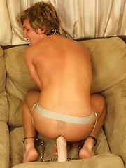 Blonde twink boy plays with huge white dildo