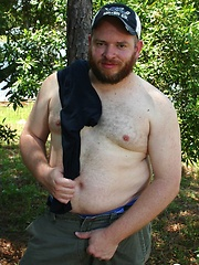 Ginger cub Sid Morgan strips naked outdoors to show off his chubby cock