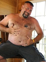 Grizzly Daddy Jake Davidson strips off his T-Shirt and shows off his hairy belly and hard cock