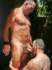 Muscle bear Steve King and Big Daddy Brock Hart cool off under a shower