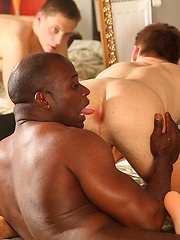 Muscled black guy tops young white gay