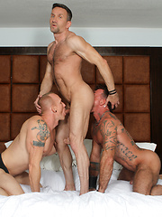 Mason kneels down in front of Ray and Matt bobbing cocks as he sucks and swallows each of them back forth