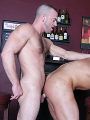 Steve Vex and Darius Soli take a quick shot at the bar and begin to make out