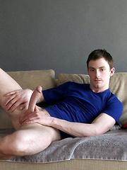 Young guy masturbates at home