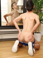 Cute twink Mischa Stone tugging on his firm dick.