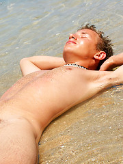 Straight boy Sander solo posing on the beach
