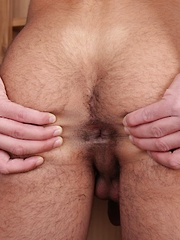 Ryan Tanek spreads his hairy ass cheeks.